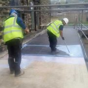 Crown workmen installing a new rubber flat roof on Halifax Mill