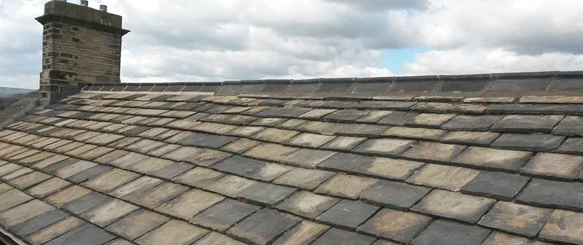 Image of new roofing slates and repair work