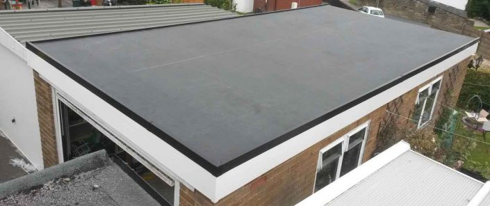 image of rubber flat roofing installation services on garage roof Halifax, West Yorkshire