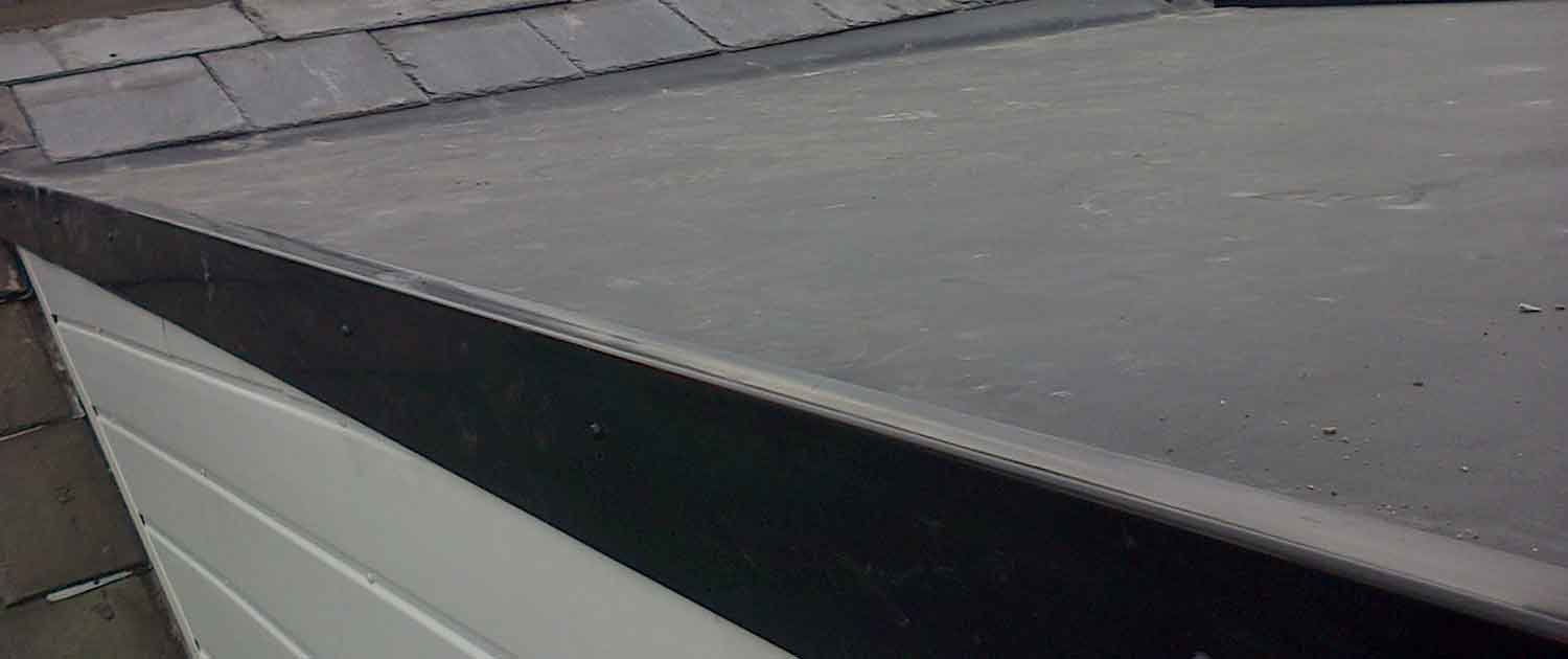 image of rubber flat roofing installation services on extenstion roof