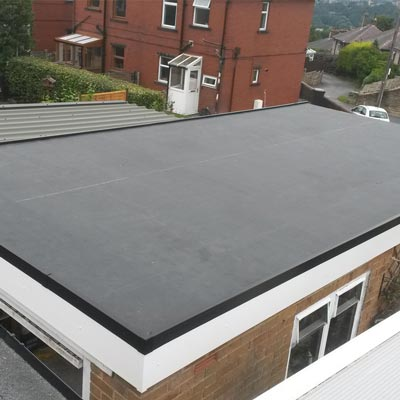 image of rubber flat roofing installation services on garage roof