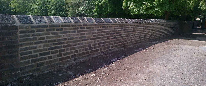 Image of new stone wall as an example of our building maintenance work
