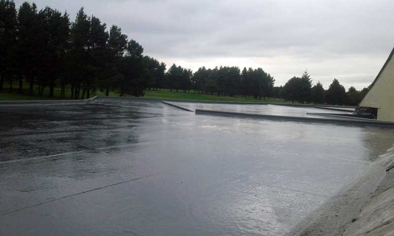image of new flat roof on west end golf club club house halifax